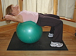 Starting position for this ab exercise with exercise ball. This is the beginner crunch.