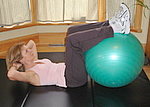Basic crunch abdominal exercise with exercise ball