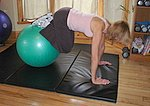 Jackknife crunch with an exercise ball